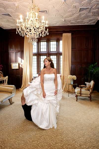 Natirar wedding photo of bride having dress bustled